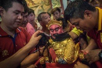 Mounting of deities on sedans as part of Chingay Ritual in Johor Bahru Malaysia