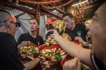 Mounting of deities on sedans as part of Chingay Ritual in Johor Bahru Malaysia
