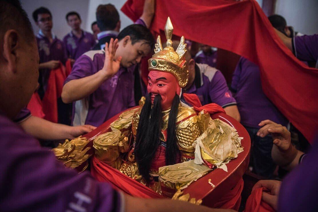 Mounting of deities on sedans as part of Chingay Ritual Johor Bahru, Malaysia