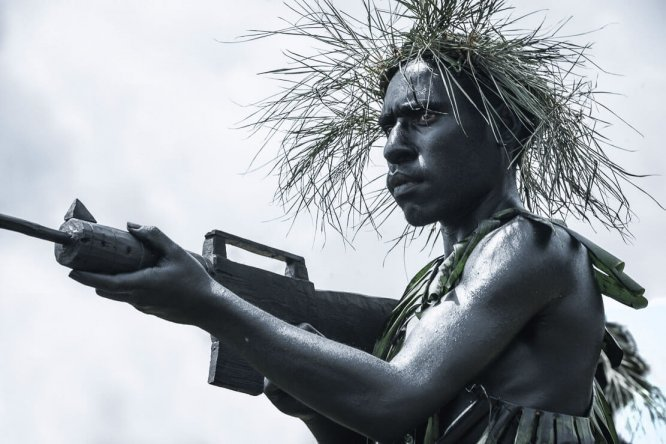 Papua New Guinea festivals: performers with wooden guns at Enga Cultural Show in Wabag