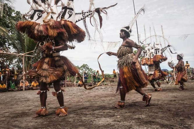 Dancers in traditional bilas at Gulf Mask Festival in Gulf province in Papua New Guinea