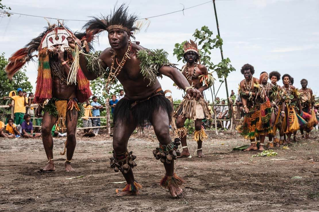Frightful-looking men throwing spears at Gulf Mask Festival in Gulf province in Papua New Guinea