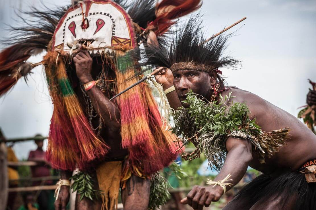 Man throwing spears at Gulf Mask Festival in Gulf province in Papua New Guinea