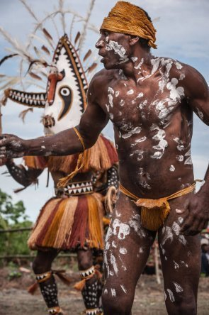Men dancing with giant masks at Gulf Mask Festival in Gulf province in Papua New Guinea