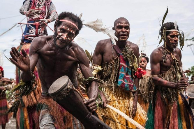 Traditional dancing and singing at Gulf Mask Festival in Gulf province of Papua New Guinea