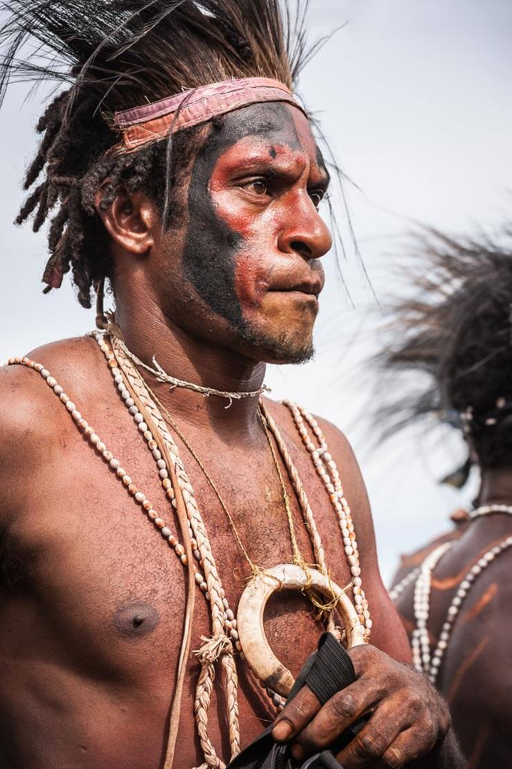 Male performer in traditional attire at Gulf Mask Festival in Gulf province in Papua New Guinea