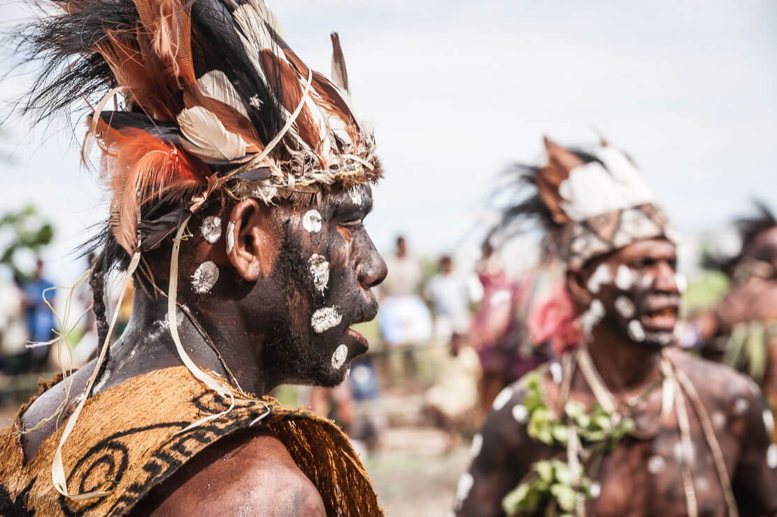 Man in traditional attire at Gulf Mask Festival in Gulf province in Papua New Guinea