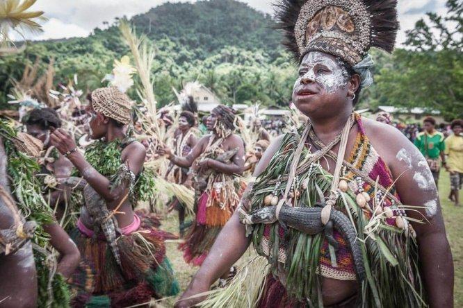 Dancing with crocodiles at Sepik River Crocodile Festival in Ambunti, East Sepik province of Papua New Guinea
