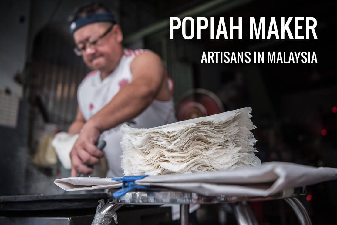 Making popiah skin at Chowrasta market in Penang