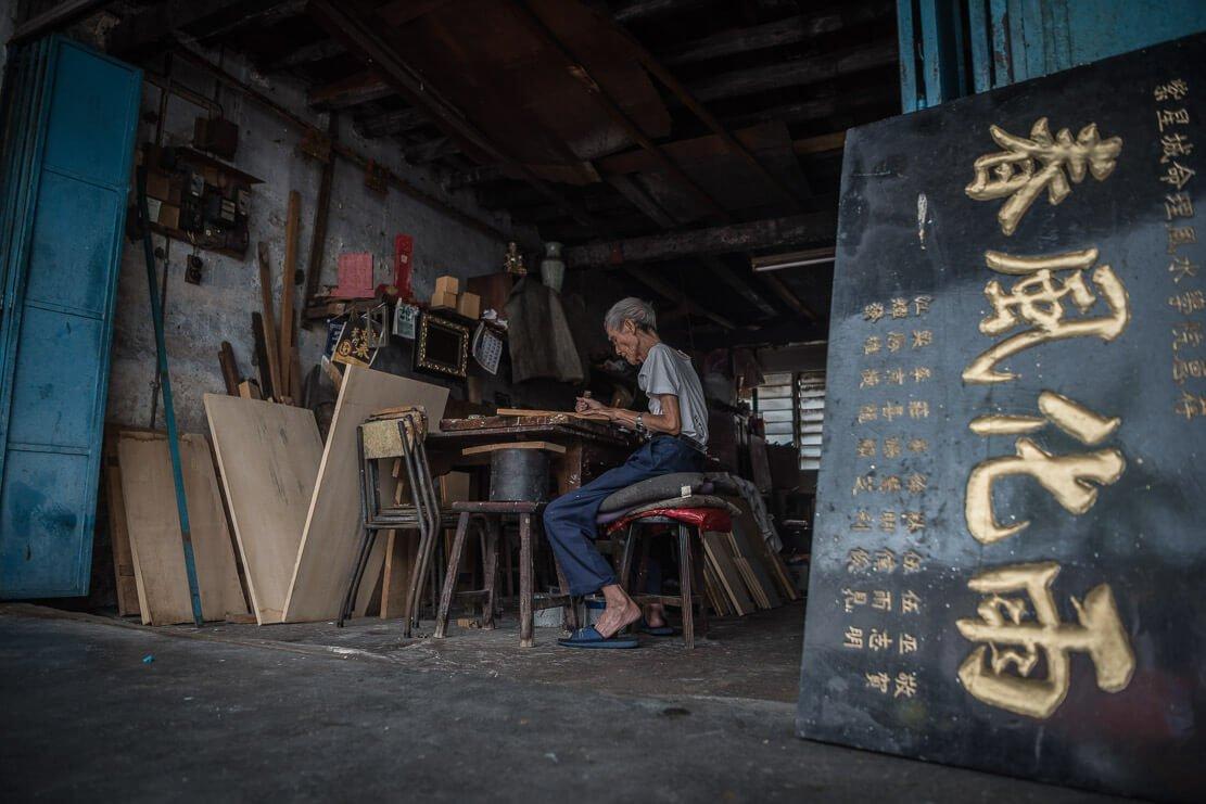 Penang traditional signboard engraver