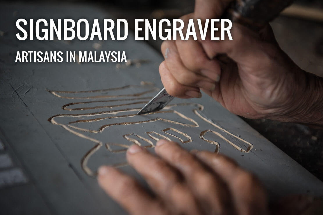 Penang signboard engraver at work