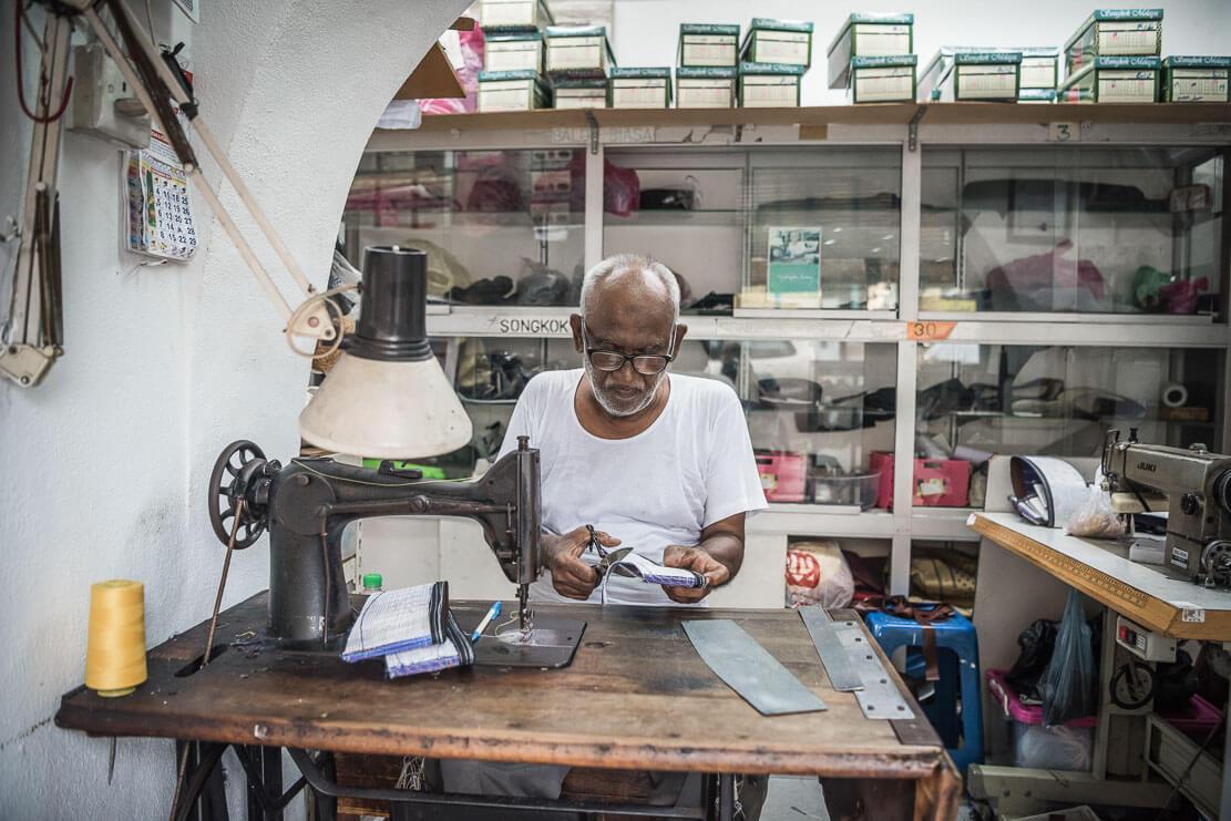 Penang artisan making songkok