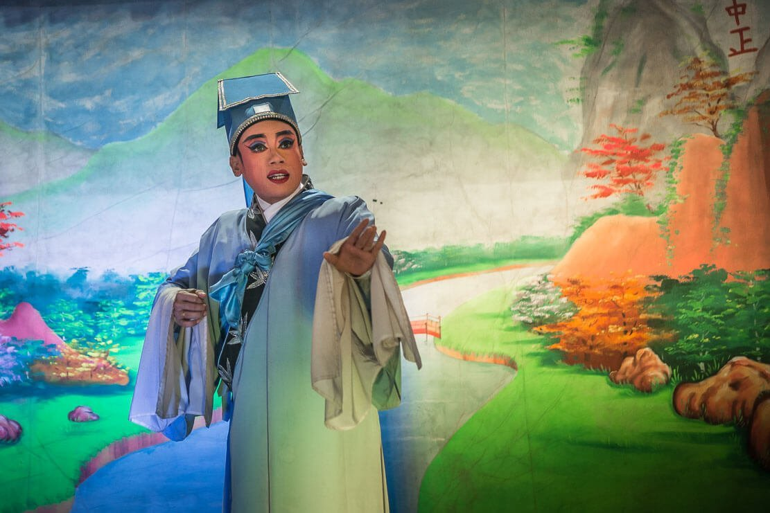 Chinese Opera artists performing on the stage