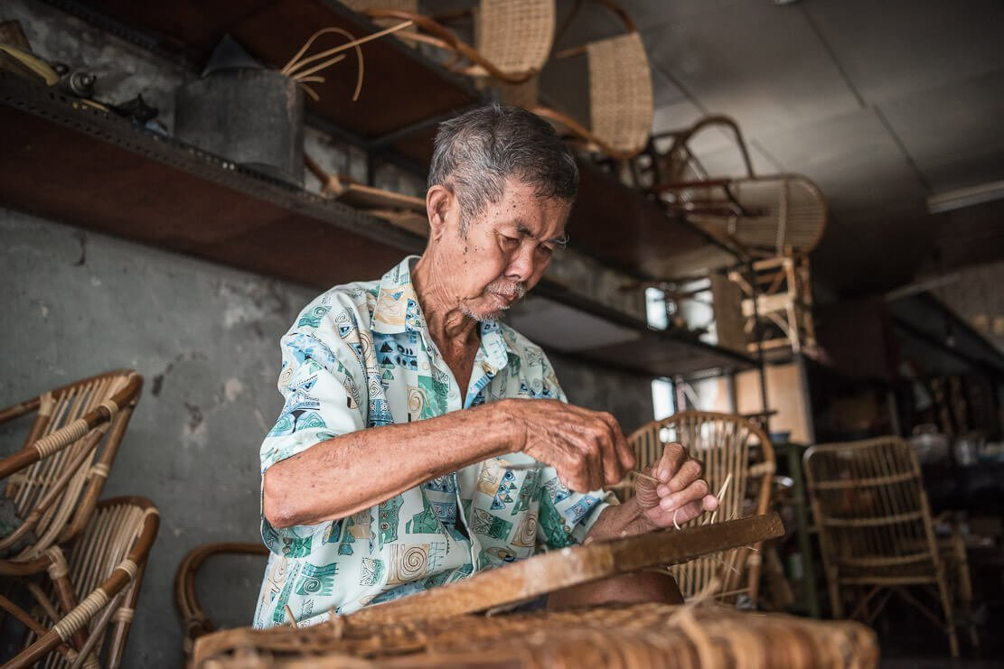 Mr. Lee Soo Kee, rattan weaver, in his shop in Penang,