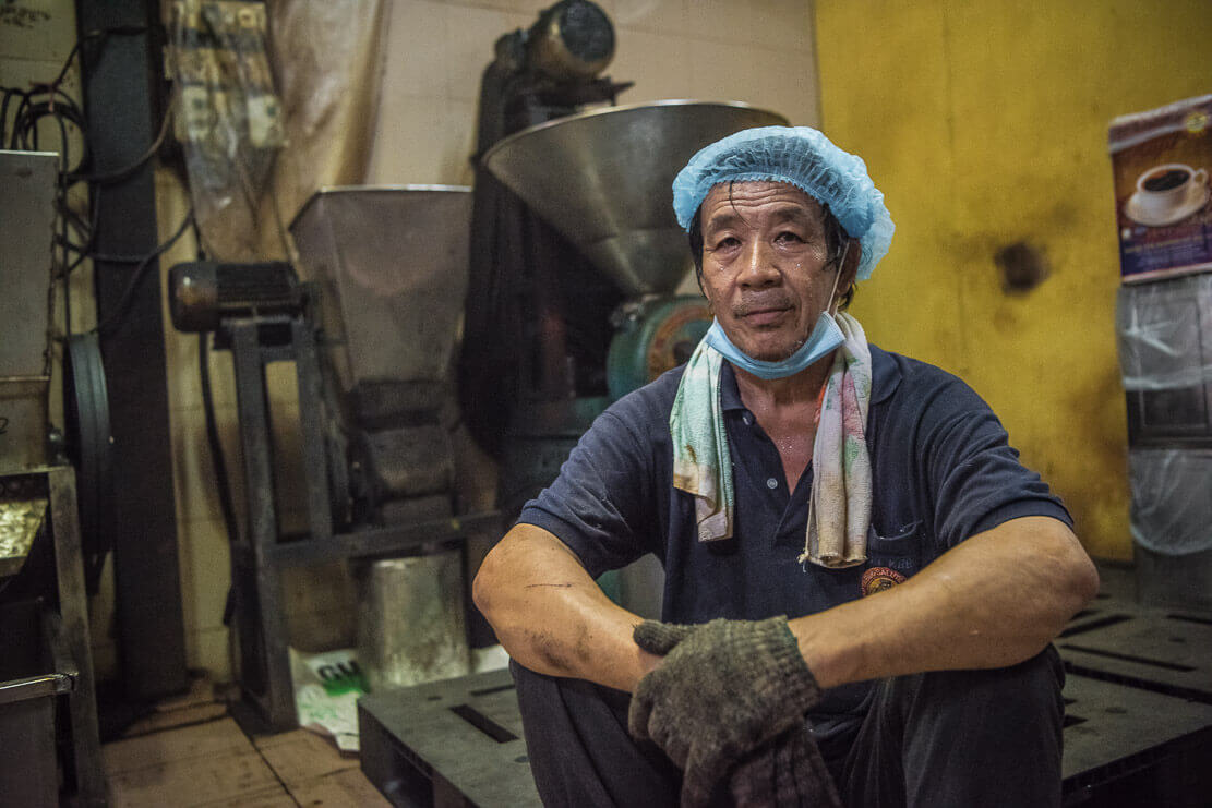 Worker at Kun Kee coffee factory