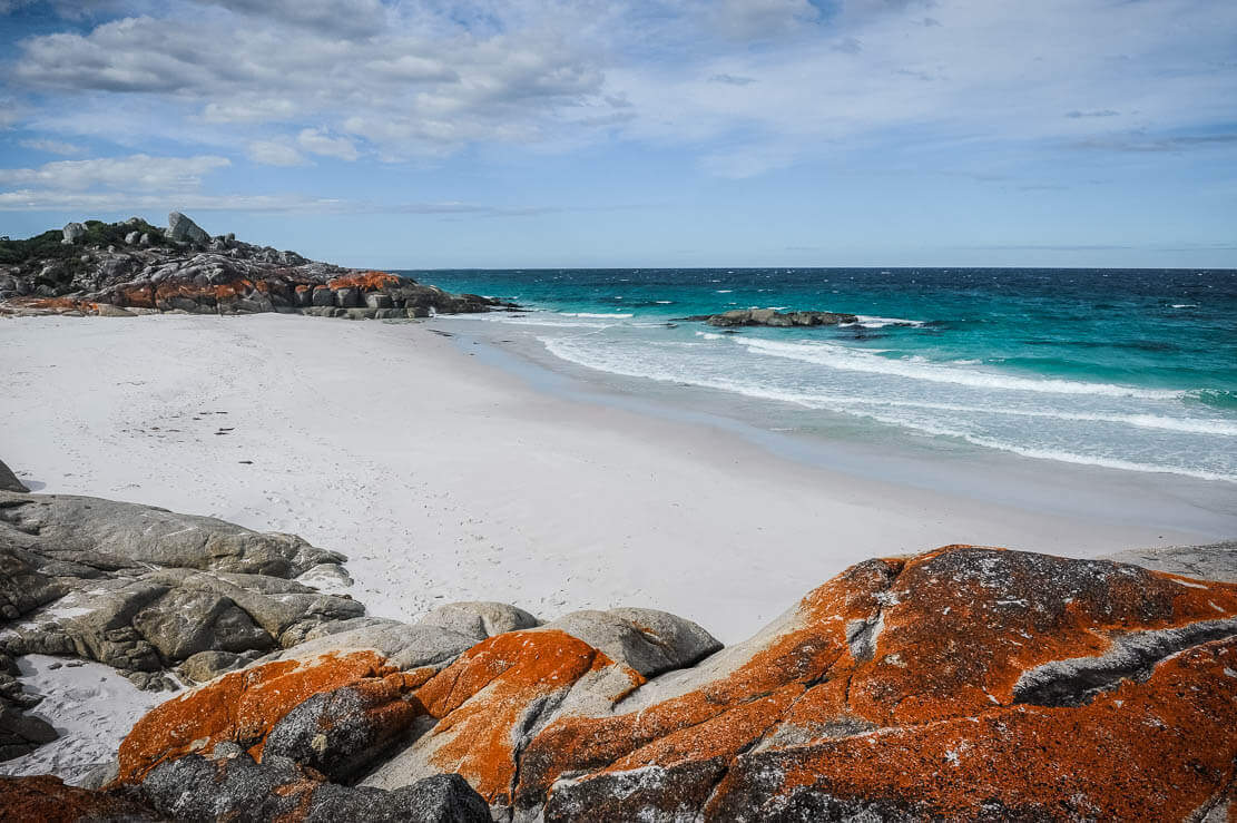 Wild landscape of Bay of Fires in Tasmania, with its pure white sandy beaches and emerald-coloured pristine waters