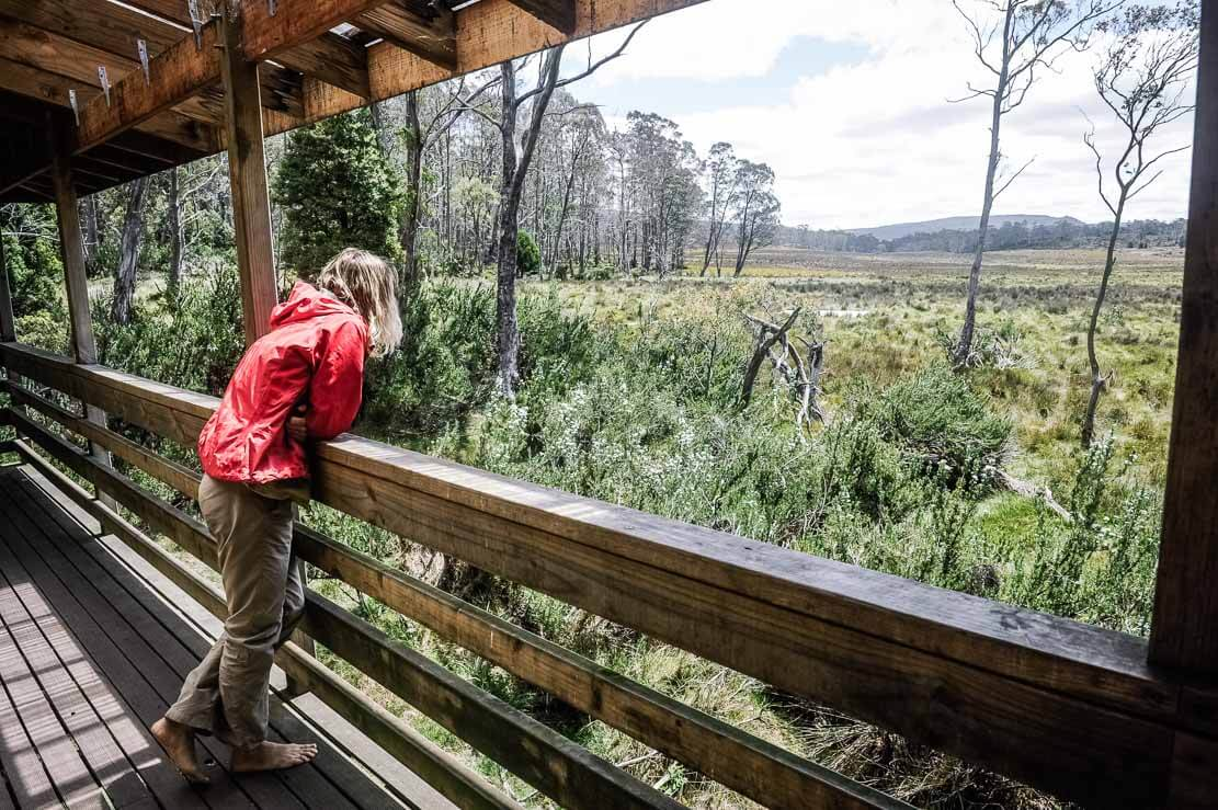 New Pelion Hut large veranda with views over picturesque button grass plains and dolerite spires of Mt Oakleigh