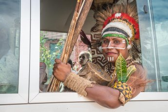 Woman from Eastern Highlands Province of Papua New Guinea taking a bus after the performance