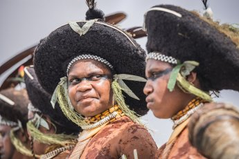 Suli Muli dancers from Enga Province of Papua New Guinea wearing distinctive round headdresses, a symbol of Engan culture